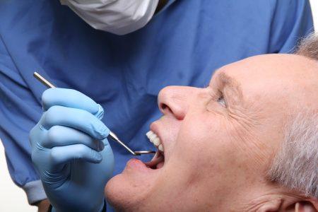 man getting denture checkup
