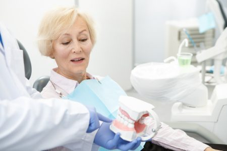 mature woman getting dentures
