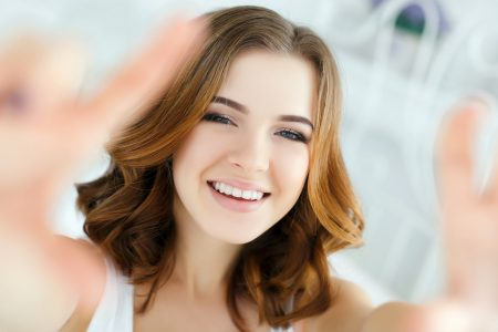 woman smiling has dental insurance